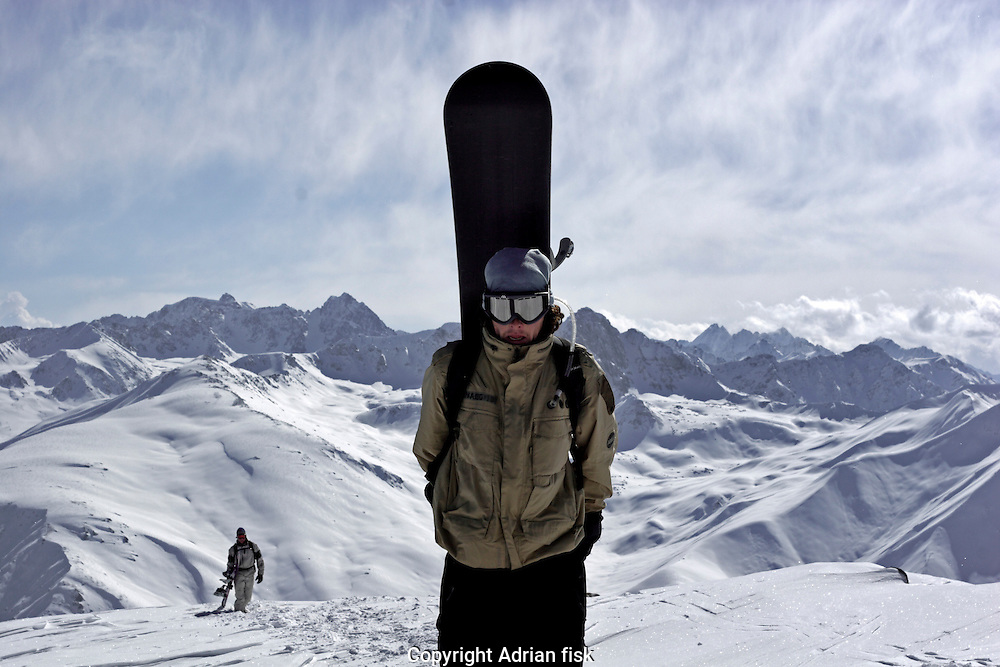 Gulmarg, Kashmir. The stunning vista of the winter Himalayas provides the backdrop for a snowboarder at the top of the Gulmarg gondola (3980m). The gondola which opened in 2005 is the worlds highest and has been drawing snowboarders and skiers from around the world. Gulmarg is only 10km from the line of control that seperates Pakistan Kashmir from Indian Kashmir which means its situated in a conflict area. But improved relations between the two countries as well as a peace process within Kashmir have meant more skiers are now flocking to the area for what is said to be some of the best skiing in the world.