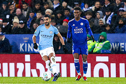 Riyad Mahrez of Manchester City takes on Demarai Gray of Leicester City - Mandatory by-line: Robbie Stephenson/JMP - 18/12/2018 - FOOTBALL - King Power Stadium - Leicester, England - Leicester City v Manchester City - Carabao Cup Quarter Finals