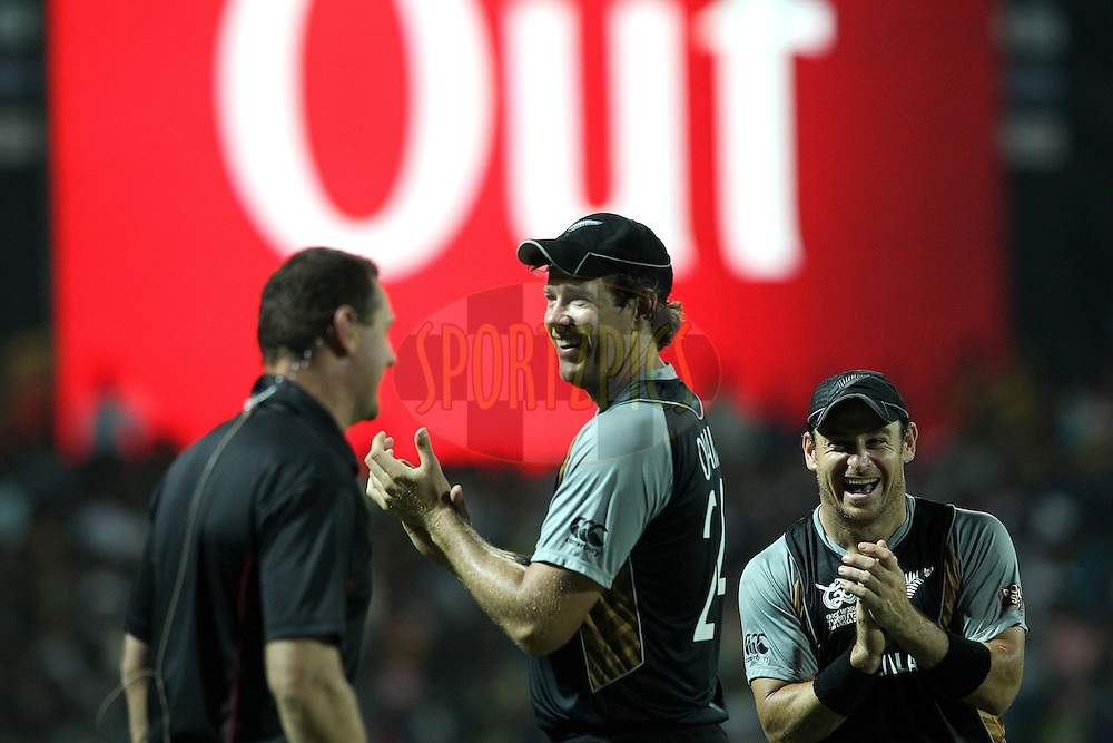 Jacob Oram and Nathan McCullum react as the Super Over is announced during the ICC World Twenty20 Super 8s match between Sri Lanka and New Zealand held at the  Pallekele Stadium in Kandy, Sri Lanka on the 27th September 2012..Photo by Ron Gaunt/SPORTZPICS/PHOTOSPORT