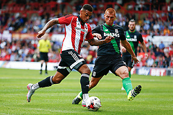 Steve Sidwell of Stoke City comes in for a tackle on Andre Gray of Brentford - Mandatory by-line: Jason Brown/JMP - Mobile 07966 386802 25/07/2015 - SPORT - FOOTBALL - Brentford, Griffin Park - Brentford v Stoke City - Pre-Season Friendly