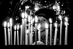 June 14, 2017 - Jerusalem, Israel - A girl lights a candle at the Church of the Holy Sepulchre. (Credit Image: © Nir Alon via ZUMA Wire)