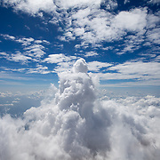 The plume from a volcanic eruption rises above the clouds from Santiaguito dome complex in Guatemala.