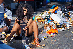 © Licensed to London News Pictures. 29/08/2016. London, UK. Revellers enjoy the second day of Notting Hill Carnival in west London, Monday 29 August 2016. Photo credit: Tolga Akmen/LNP