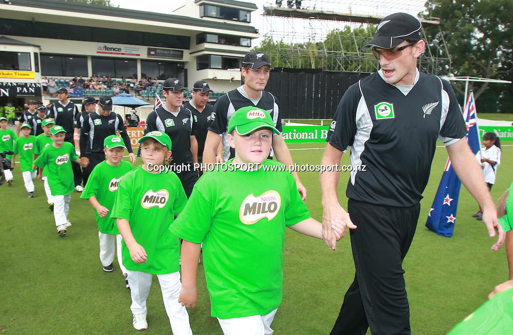 Kyle Mills leads the Milo klds onto the filed at the 5th ODI, Black Caps v Pakistan, One Day International Cricket. Seddon Park, Hamilton, New Zealand. Wednesday 3 February 2011. Photo: Andrew Cornaga/photosport.co.nz
