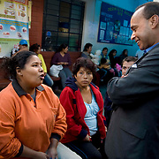Congressman Luis Gutierrez (D,IL,)  and his wife Soraida, listen to expecting mothers during CARE's Learning Tour visit to the San Cosme Health Center. San Cosme is a slum in Lima that has the highest rate of tuberculosis in Lima, but has limited health services for the community. The Global Fund is supporting services in San Cosme's health center.