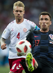 July 1, 2018 - Nizhny Novgorod, Russia - Simon Kjaer of Denmark vies Mario Mandzukic of Croatia during the 2018 FIFA World Cup Russia Round of 16 match between Croatia and Denmark at Nizhny Novgorod Stadium on July 1, 2018 in Nizhny Novgorod, Russia. (Credit Image: © Foto Olimpik/NurPhoto via ZUMA Press)