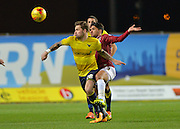 Oxford United Forward Chris Maguire and Northampton Town Midfielder Danny Rose during the Sky Bet League 2 match between Oxford United and Northampton Town at the Kassam Stadium, Oxford, England on 16 February 2016. Photo by Adam Rivers.