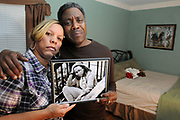 (Mara Lavitt &mdash; New Haven Register) <br /> December 12, 2013 West Haven<br /> Celeste and Gregory Fulcher, parents of Key Club shooting victim Erika Robinson, in her bedroom at their home in West Haven.