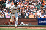 San Francisco Giants second baseman Joe Panik (12) runs to first base but grounds out against the Pittsburgh Pirates at AT&T Park in San Francisco, Calif., on August 17, 2016. (Stan Olszewski/Special to S.F. Examiner)