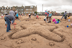 Portobello Prom is packed this aftrnoon with buskers of all ages and styles for the tenth annual Big Beach Busk. And on the sand was the annual sandcastle competition that takes place at the same time.<br /> <br /> <br /> © Jon Davey/ EEm