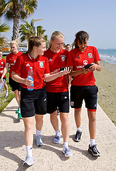 LARNACA, CYPRUS - Tuesday, March 6, 2018: Wales' Alice Griffiths, Elise Hughes and Amina Vine during a team walk around the Palm Beach Hotel & Bungalows in Larnaca on day eight of the Cyprus Cup tournament. (Pic by David Rawcliffe/Propaganda)
