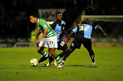 Yeovil Town's Korey Smith  dribbles past both Wycombe Wanderers' Junior Morias and Wycombe Wanderers' Ade Azeez - Photo mandatory by-line: Dougie Allward/JMP  - Tel: Mobile:07966 386802 04/12/2012 - SPORT - FOOTBALL - Johnstone's Paint Trophy  -  Yeovil  -  Huish Park  -  Yeovil Town V Wycombe Wanderers