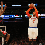Carmelo Anthony, New York Knicks, shooting three during the New York Knicks vs Milwaukee Bucks, NBA Basketball game at Madison Square Garden, New York. USA. 15th March 2014. Photo Tim Clayton
