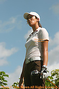 Fifteen year old Michelle Wie stares down the fairway after a tee shot during a practice round prior to The 2005 Sony Open In Hawaii. The event was held at the Waialae Country Club in Honolulu, Hawaii.