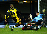 Photo. Chris Ratcliffe<br />Southend United v Bristol Rovers. FA Nationwide 3rd Division. 20/12/2003<br />Lewis Haldane tries to get a shot in as Leon Cort lies dopwn and eeper Darryl Flahavan