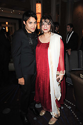 PABLO GANGULI and LADY NAIPAUL at the Liberatum Dinner hosted by Ella Krasner and Pablo Ganguli in honour of Sir V S Naipaul at The Landau at The Langham, Portland Place, London on 23rd November 2010.