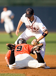 Virginia Cavaliers infielder Tyler Cannon (10) tags out Oregon State Beavers OF Braden Wells (9) on a play at second. The Oregon State Beavers defeated the Virginia Cavaliers 5-3 in Game 6 of the NCAA World Series Charlottesville Regional held at Davenport Field in Charlottesville, VA on June 4, 2007.
