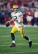 Green Bay Packers quarterback Aaron Rodgers (12) rolls to his right as he looks to pass during the NFL NFC Divisional round playoff football game against the Arizona Cardinals on Saturday, Jan. 16, 2016 in Glendale, Ariz. The Cardinals won the game in overtime 26-20. (©Paul Anthony Spinelli)