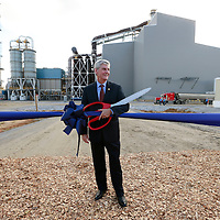 Thomas Wells | BUY AT PHOTOS.DJOURNAL.COM<br /> Gov. Phil Bryant stands ready with an oversized pair of scissors for the ribbon cutting to officially open the new Mississippi Silicon plant in Burnsville on Wednesday.