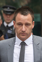 © London News Pictures. 13/07/2012. London, UK. England Footballer and Chelsea FC Captain JOHN TERRY leaving Westminster Magistrates court on July 13, 2012, where a verdict  of not guilty was returned  today in John Terry's trial for allegedly using a racist obscenity about Queens Park Rangers player Anton Ferdinand. Photo credit: Ben Cawthra/LNP.