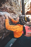 People practicing boulder in Rodeno forest in Albarracin, Spain