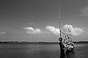 Fishing boat on Volta river near Ada, Ghana.