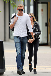 Model Abbey Clancy and husband Peter Crouch out and about in north London. The Stoke City striker was a pure gent as he carried Abbey's designer handbag as they walked hand in hand... UK. 19/08/2014<br />BYLINE MUST READ : JAMESY/GOTCHA IMAGES<br /><br />Copyright by © Gotcha Images Ltd. All rights reserved.<br />Usage of this image is conditional upon the acceptance <br />of Gotcha Images Ltd, terms and conditions available at<br />www.gotchaimages.com