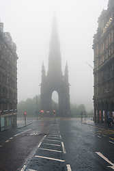 Edinburgh, Scotland, UK. 13 June 2020. On a foggy wet Saturday afternoon the streets of Edinburgh city centre remain very quiet and shops and businesses remain closed. Lockdown is expected to be relaxed next month.  Scott Monument on Princes Street isolated with nobody on the surrounding streets. Iain Masterton/Alamy Live News