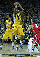 January 07, 2011: Iowa Hawkeyes guard Bryce Cartwright (24) puts up a shot over Ohio State Buckeyes guard Aaron Craft (4) during the the NCAA basketball game between the Ohio State Buckeyes and the Iowa Hawkeyes at Carver-Hawkeye Arena in Iowa City, Iowa on Saturday, January 7, 2012.