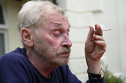 Portrait of Registered Care Home service user smoking a cigarette outside,