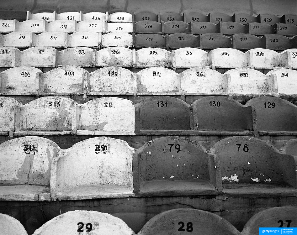Playing with Ghosts... Football Stadiums of Argentina..Argentina, one of the powerhouses of World Football is steeped in history and tradition, so too are the countries stadiums. Many were built in the early part of the 1900's and maintain an incredible unique atmosphere of their own. Empty stadiums terraces sing to the observer, holding onto the fans voices from match days past when Argentina's fans show a passion for the game and their clubs which is second to none. The historic stadiums have a voice of their own and a unique atmosphere. ..Concrete seating at Estadio Tomás Adolfo Ducó, the home of Club Atlético Huracán, known simply as Huracán. The club are situated in the Parque Patricios neighbourhood of Buenos Aires, Argentina.  The stadium was opened 11 September 1949 and has a capacity of  48,314.