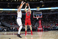 December 27, 2017 - Chicago, IL, USA - The Chicago Bulls' Lauri Markkanen (24) takes a shot over the New York Knicks' Kristaps Porzingis during the first half at the United Center in Chicago on Wednesday, Dec. 27, 2017. (Credit Image: © Armando L. Sanchez/TNS via ZUMA Wire)