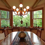 WILMINGTON, DE - AUGUST 8, 2016: The dining room on the first floor has a grand three-bay view of the two acres of lush gardens designed and maintained by the owners. 19 Crestfield Road, Wilmington, DE. Credit: Albert Yee for The New York Times
