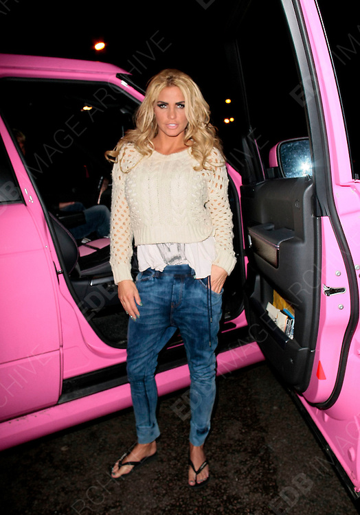 19.JANUARY.2012. LONDON<br /> <br /> KATIE PRICE STOPS TRAFFIC TO POSE FOR PICTURES IN WEST LONDON<br /> <br /> BYLINE: EDBIMAGEARCHIVE.COM<br /> <br /> *THIS IMAGE IS STRICTLY FOR UK NEWSPAPERS AND MAGAZINES ONLY*<br /> *FOR WORLD WIDE SALES AND WEB USE PLEASE CONTACT EDBIMAGEARCHIVE - 0208 954 5968*