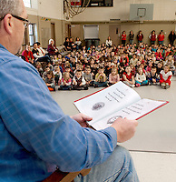 "Elm Street School Principal Mr. Johnson recites ""Twas the Night Before Christmas"" to his students before they get ready ""to dash away....dash away all"" for Christmas break Friday afternoon.  (Karen Bobotas/for the Laconia Daily Sun)"