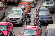 """20 MAY 2104 - BANGKOK, THAILAND: Traffic in Bangkok Tuesday. The Thai Army declared martial law throughout Thailand in response to growing political tensions between anti-government protests led by Suthep Thaugsuban and pro-government protests led by the """"Red Shirts"""" who support ousted Prime Minister Yingluck Shinawatra. Despite the declaration of martial law, daily life went on in Bangkok in a normal fashion. There were small isolated protests against martial law, which some Thais called a coup, but there was no violence.   PHOTO BY JACK KURTZ"""