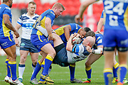 Featherstone Rovers second row John Davies (12) is tackled during the Challenge Cup 2018 match between Doncaster and Featherstone Rovers at the Keepmoat Stadium, Doncaster, England on 22 April 2018. Picture by Simon Davies.