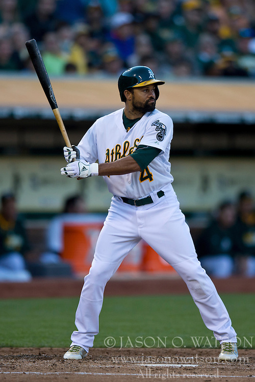 OAKLAND, CA - JULY 05:  Coco Crisp #4 of the Oakland Athletics at bat against the Toronto Blue Jays during the second inning at O.co Coliseum on July 5, 2014 in Oakland, California. The Oakland Athletics defeated the Toronto Blue Jays 5-1.  (Photo by Jason O. Watson/Getty Images) *** Local Caption *** Coco Crisp