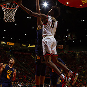 09 December 2017:  The San Diego State men's basketball team hosts the California Golden Bears Saturday afternoon. San Diego State Aztecs forward Jalen McDaniels (5) goes up for a lay-up along the baseline while being defended by a Cal player. The Aztecs lost 63-62 to Cal.<br /> www.sdsuaztecphotos.com