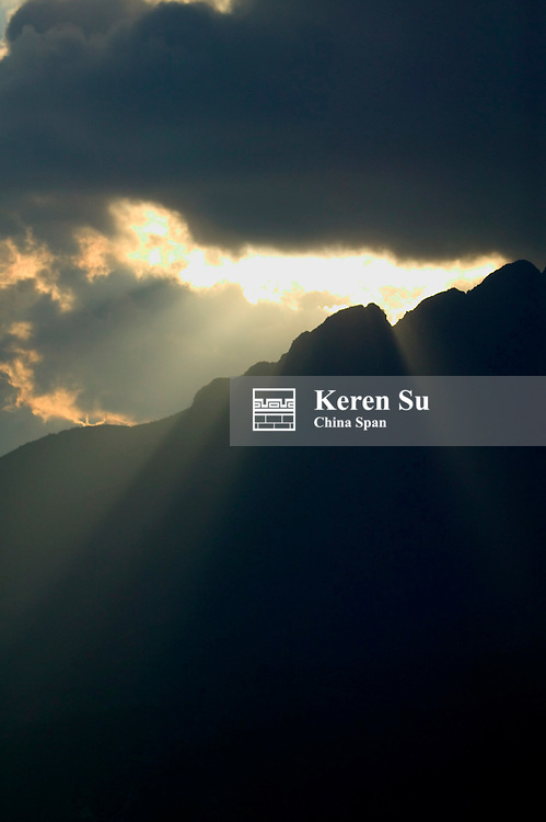 Mountain in mist at sunrise, Yuanyang, Yunnan Province, China