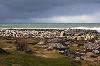 Rain clouds at the Giant's Causeway coastline in Antrim Northern Ireland