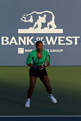 July 26, 2011; Stanford, CA, USA;  Serena Williams (USA) stands on the baseline against Anastasia Rodionova (AUS), not pictured, during the first round of the Bank of the West Classic women's tennis tournament at the Taube Family Tennis Stadium.