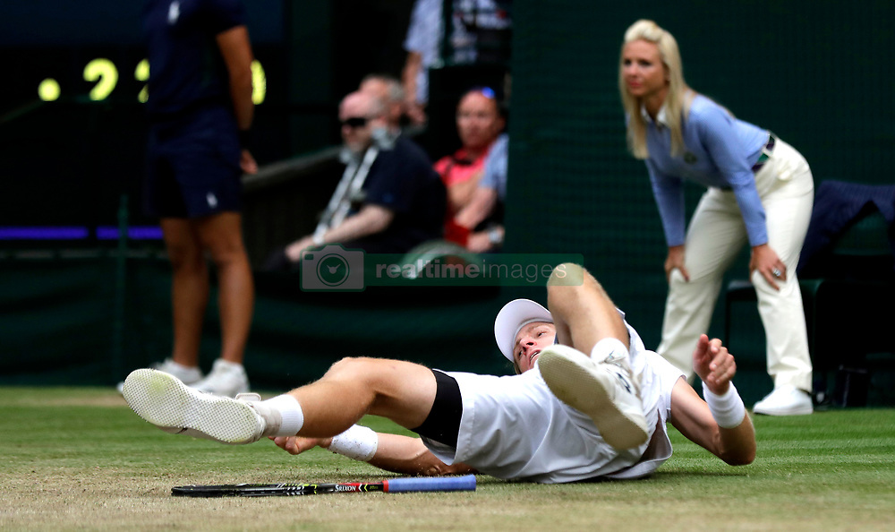 Kevin Anderson slips during the match on day eleven of the Wimbledon Championships at the All England Lawn Tennis and Croquet Club, Wimbledon. PRESS ASSOCIATION Photo. Picture date: Friday July 13, 2018. See PA story TENNIS Wimbledon. Photo credit should read: Ben Curtis/PA Wire. RESTRICTIONS: Editorial use only. No commercial use without prior written consent of the AELTC. Still image use only - no moving images to emulate broadcast. No superimposing or removal of sponsor/ad logos. Call +44 (0)1158 447447 for further information.