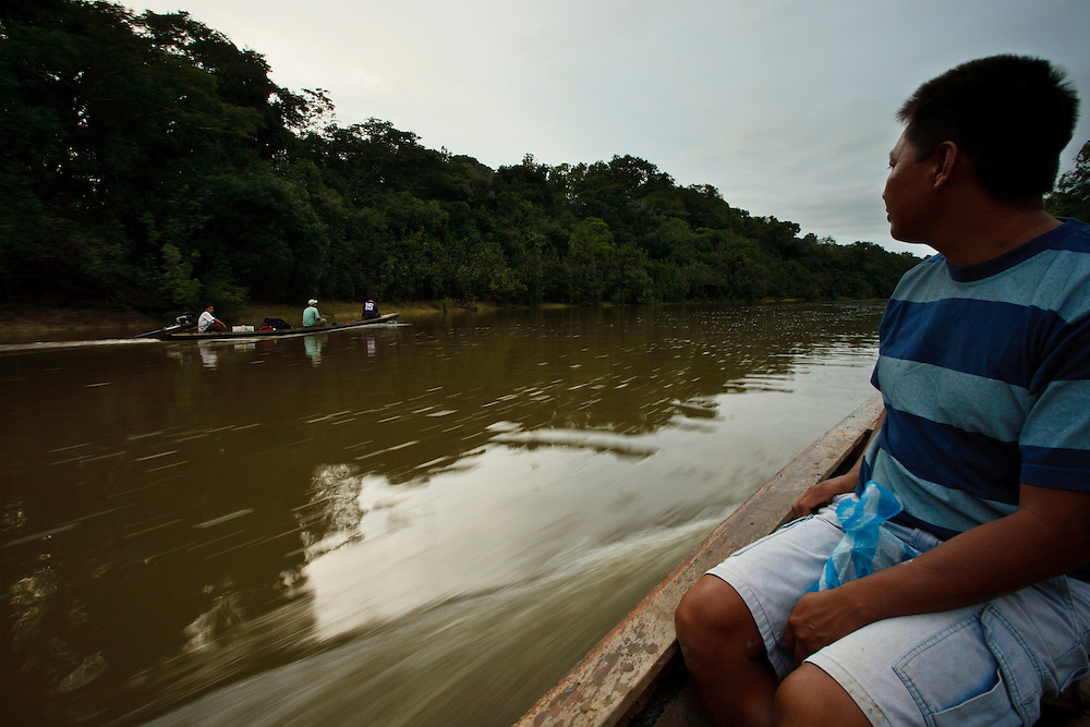 Guides return to camp on a tributuary of the Amazon river, Amazonas, Brazil