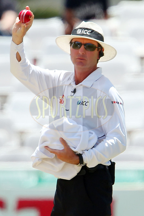 The Umpire offers the new ball to South Africa during the 3rd day of the 1st Sunfoil Test match between South Africa and New Zealand held at Newlands Stadium in Cape Town, South Africa on the 4th January 2013..Photo by Ron Gaunt/SPORTZPICS .