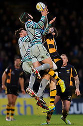 Leicester Winger (#11) Adam Thompstone and Full Back (#15) Mathew Tait jump in the air for a high ball during the second half of the match - Photo mandatory by-line: Rogan Thomson/JMP - Tel: Mobile: 07966 386802 25/11/2012 - SPORT - RUGBY - Adams Park - High Wycombe. London Wasps v Leicester Tigers - Aviva Premiership.
