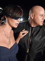 Woman in sunglasses with bodyguard