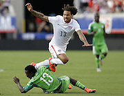 JACKSONVILLE, FL - JUNE 07:  Midfielder Jermaine Jones #13 of the United States is tripped up by defender Juwon Oshaniwa #13 of Nigeria during the international friendly match at EverBank Field on June 7, 2014 in Jacksonville, Florida.  (Photo by Mike Zarrilli/Getty Images)