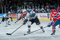 KELOWNA, CANADA - MARCH 7: Tyson Baillie #24 of Kelowna Rockets passes the puck against the Spokane Chiefs on March 7, 2015 at Prospera Place in Kelowna, British Columbia, Canada.  (Photo by Marissa Baecker/Shoot the Breeze)  *** Local Caption *** Tyson Baillie;