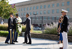 September 11, 2016 - Arlington, VA, United States of America - U.S President Barack Obama places a wreath at the Pentagon Memorial during a remembrance ceremony commemorating the 15th anniversary of the 9/11 terrorist attacks at the Pentagon September 11, 2016 in Arlington, Virginia. (Credit Image: © Pete Souza/Planet Pix via ZUMA Wire)